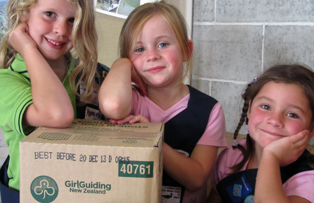 FUNDRAISING CHALLENGE: Pippins girls, from left, Poppy Wheeler, Sarah Anderson and Deja Proudman with some of the many Girl Guide biscuits the Geraldine groups need to sell when the annual fundraiser returns next week.