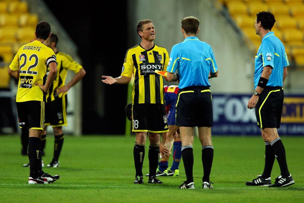 Ben Sigmund has words with the referee after the Phoenix's loss to Adelaide.