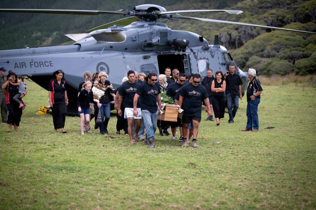 Ralph Hotere's coffin arrives by Air Force helicopter at the Mitimiti marae in Northland
