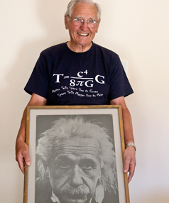 Roy Kerr, with a photograph of Albert Einstein, has become the first New Zealander to be  awarded the Einstein Medal by the Albert Einstein Society in Switzerland. Professor Kerr has earned the award for his 1963 discovery of a solution to Einstein's gravitational field equations.
