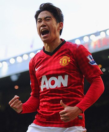 3d6ca95a1 HISTORY MAKER  Shinji Kagawa celebrates one of this three goals for Manchester  United in their