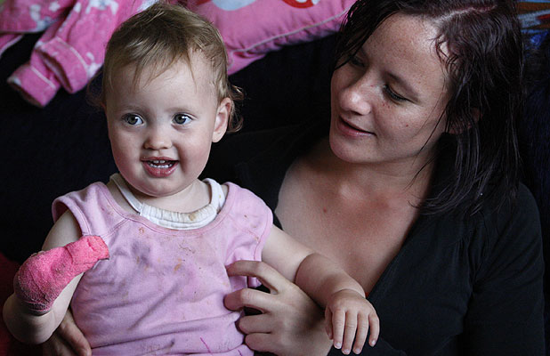 LEFT WAITING: Alicia Te Huna and her 18-month-old daughter Jakaya.