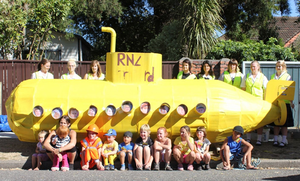 Community building: Marlborough Girls' College volunteers and children from Stratford St with the yellow submarine they built during the street intensive street cleanup project this week.