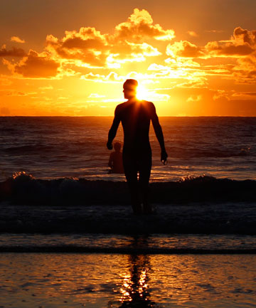 "EXTREME WEATHER: A man leaves the water after swimming at Sydney's Coogee beach at sunrise. Australia's summer has been called everything from ""extreme"" to ""angry""."