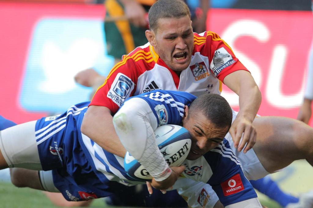 Stormers wing Bryan Habana is tackled during the Super Rugby match between DHL Stormers and the Chiefs.
