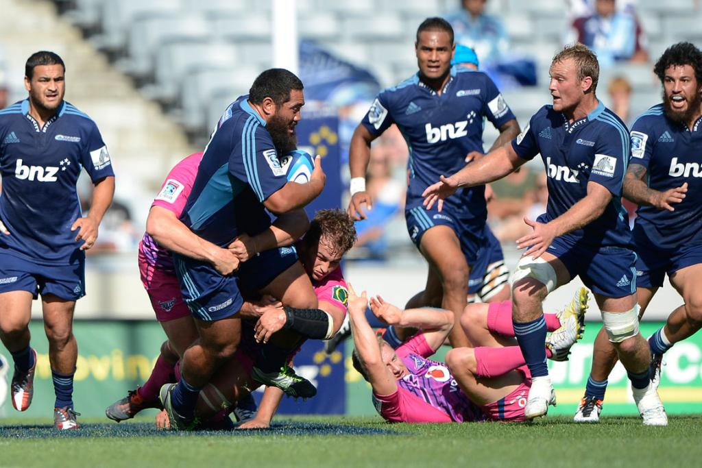 Charlie Faumuina on the attack for the Blues.