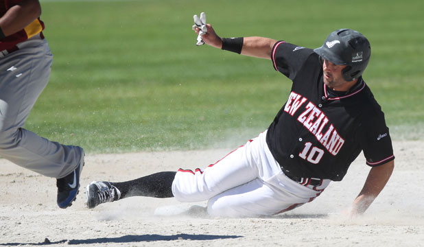THREE BATTED IN: Rhys Casley slides into second base.
