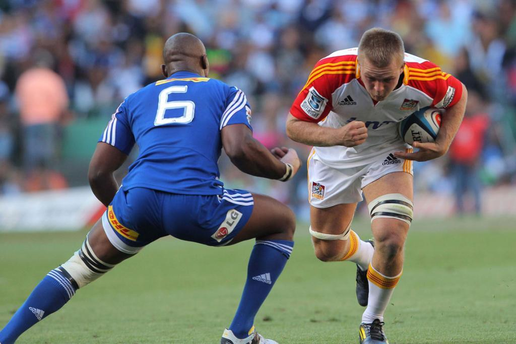 Sam Cane charges headlong into the Stormers' defence.
