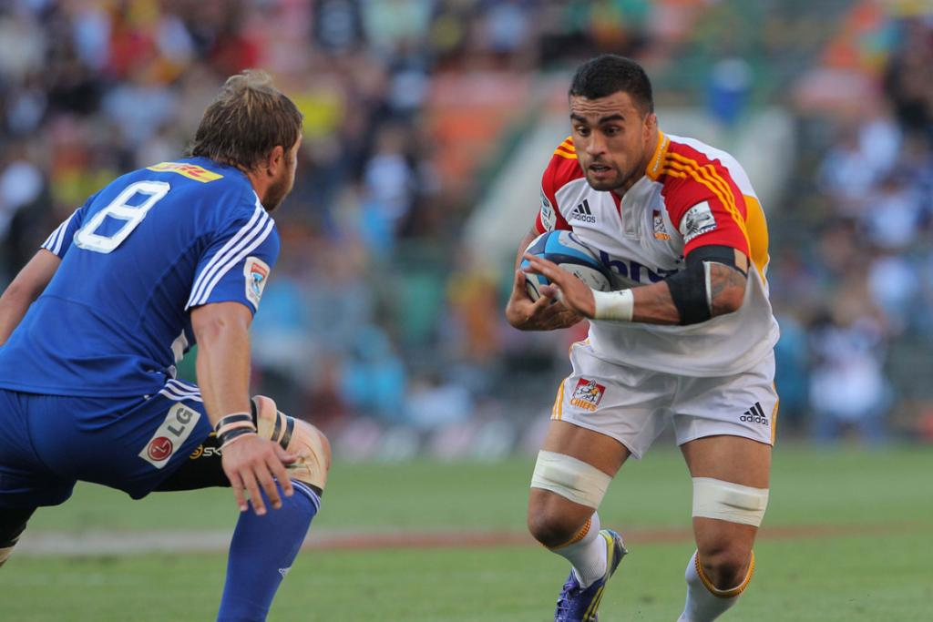 Liam Messam charges ahead for the Chiefs.
