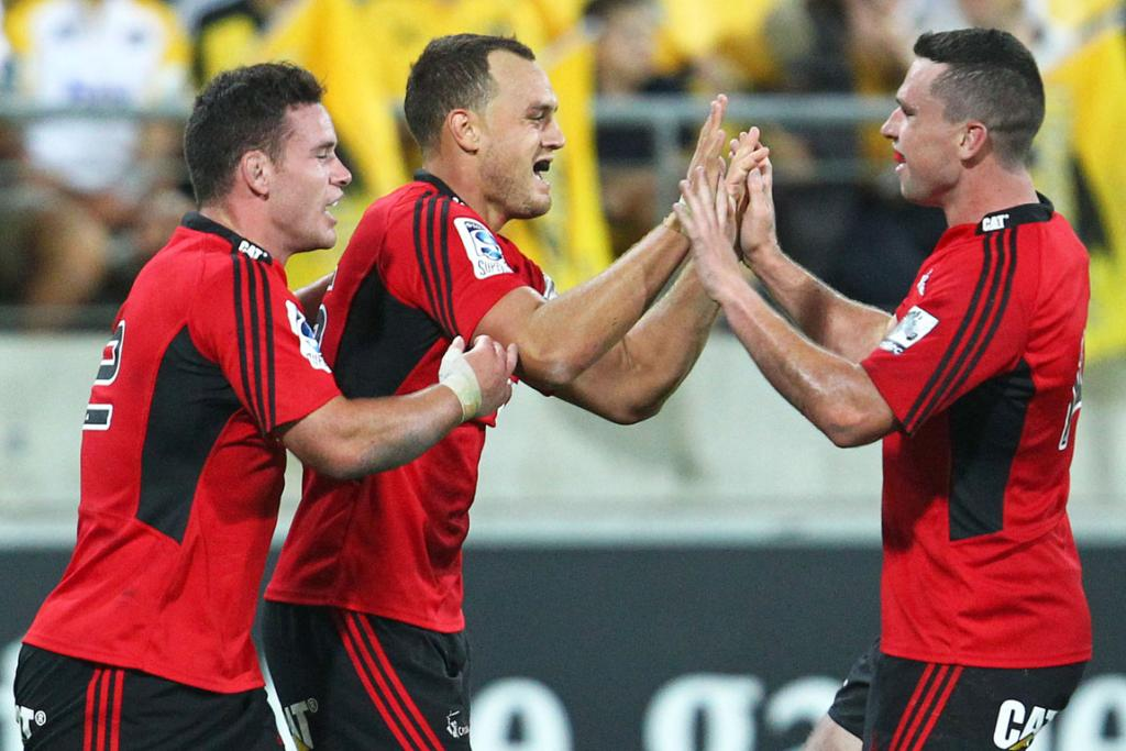 Israel Dagg (centre) celebrates with team-mates after scoring against the Hurricanes.