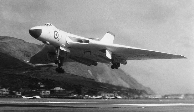 "TRICK FLIGHT: A Vulcan bomber performs a ""roller"" at Wellington Airport in 1959 ahead of the near miss that could have been fatal."