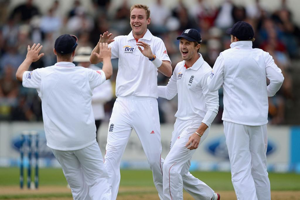 Stuart Broad of England celebrates with teammates after dismissing Ross Taylor.
