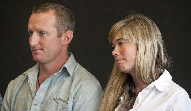 REGRETS: Henry Worsp sits with Gabrielle Molloy, partner of the deceased James Dodds who was accidentally shot by Worsp.
