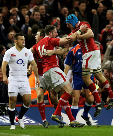 CHAMPS: Alex Cuthbert (14) of Wales celebrates with teammates after scoring his team's second try.