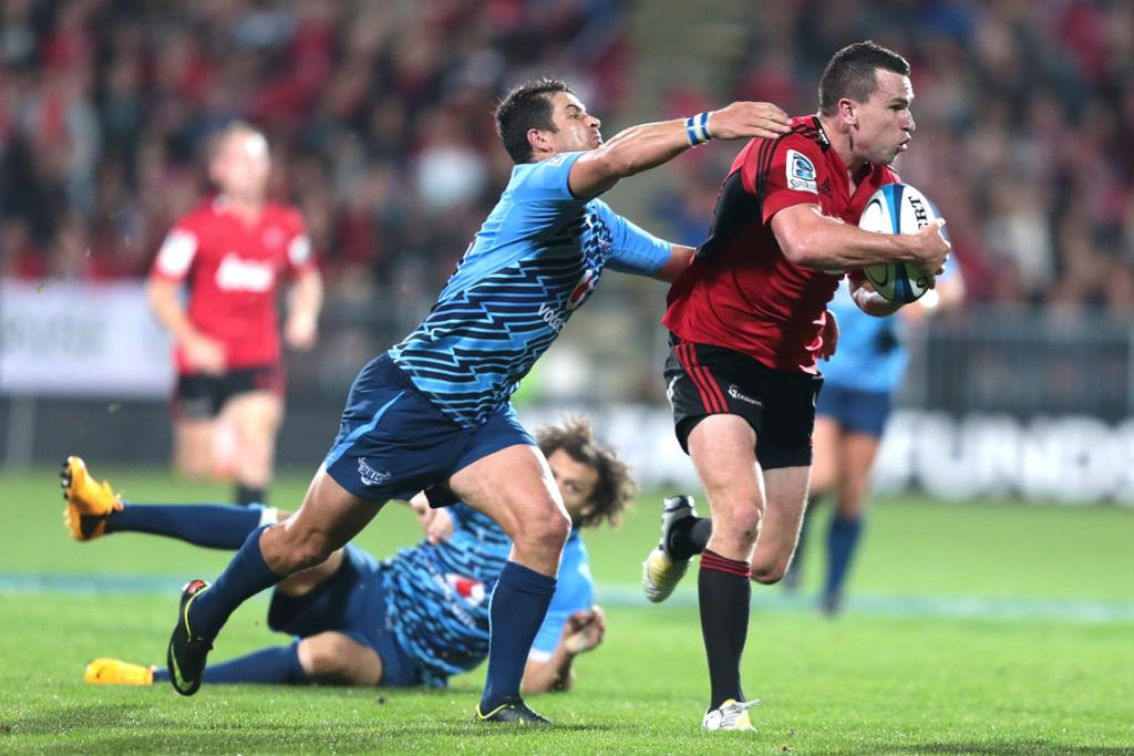 Ryan Crotty makes a break during the Crusaders win over the Bulls.