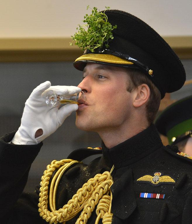 Britain's Prince William takes a drink of sherry during a visit with his wife, Catherine, Duchess of Cambridge, to attend a St Patrick's Day Parade at Mons Barracks in Aldershot.
