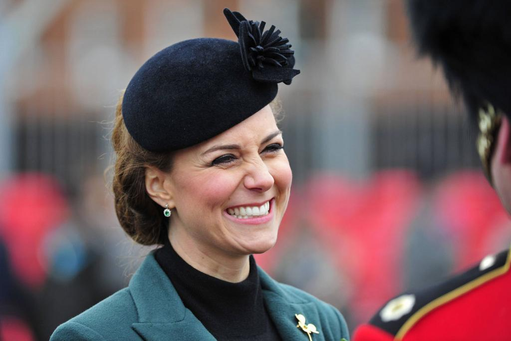 Britain's Catherine, Duchess of Cambridge smiles during a visit with her husband, Prince William, to attend a St Patrick's Day Parade at Mons Barracks in Aldershot, southern England.
