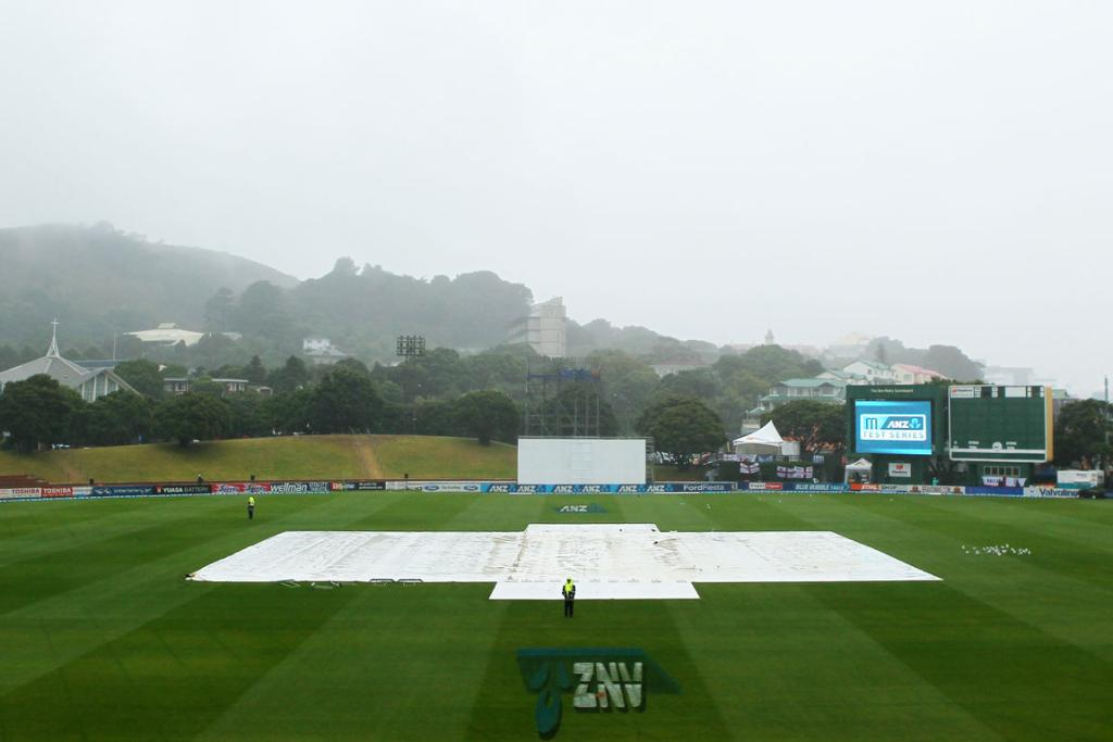 The pitch is covered as rain continues to fall on day five of the second test at the Basin Reserve.