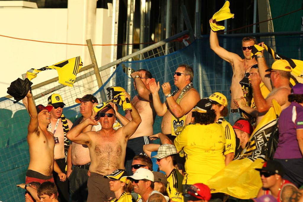 Travelling Wellington Phoenix fans celebrate during the win over Perth Glory.