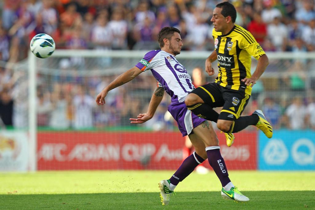 Leo Bertos (left) competes for the ball with Joshua Risdon of Perth Glory.
