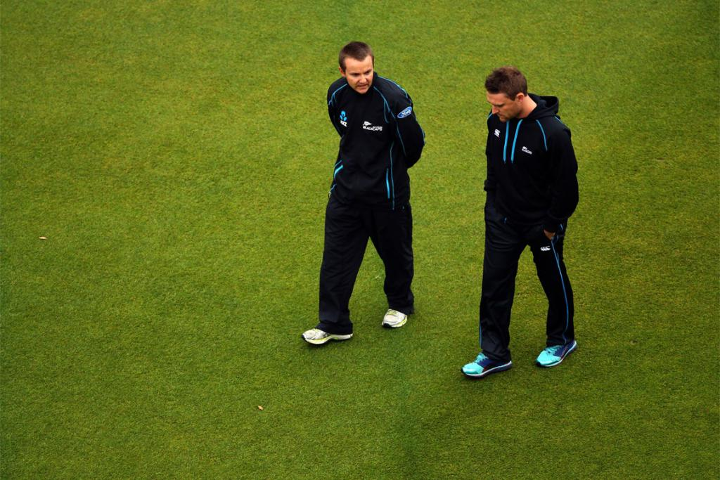 Black Caps' coach Mike Hesson (left) and captain Brendon McCullum survey the scene on a sodden Basin Reserve.