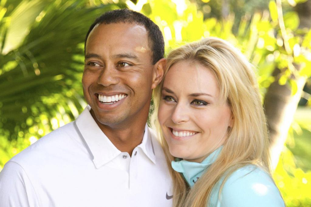 HOLD ME: Tiger Woods and Lindsey Vonn.