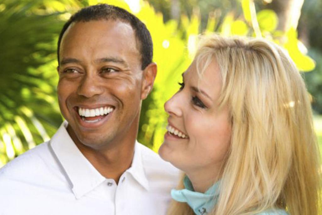 ALL SMILES: Tiger Woods and Lindsey Vonn.
