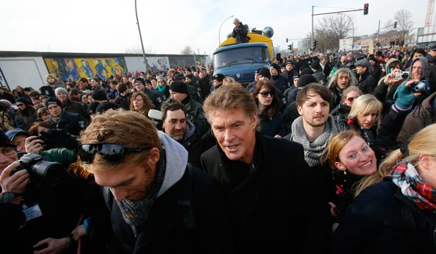 """SIGNING ON: David Hasselhoff attends a demonstration along the open air painted section of the Berlin Wall known as the """"East Side Gallery"""" in Berlin."""