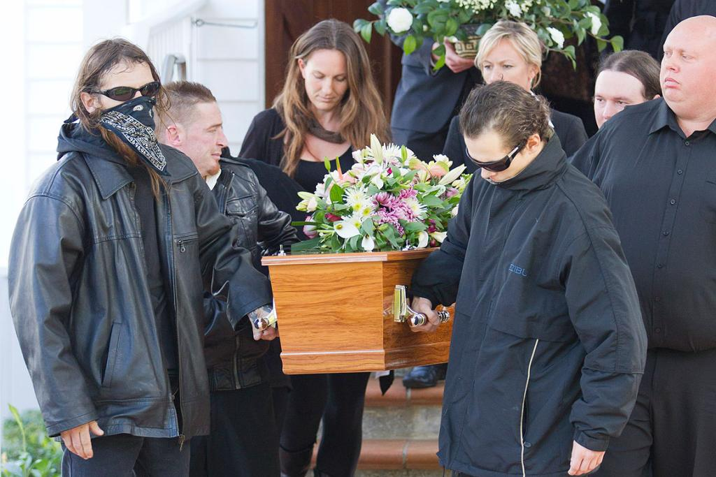The casket of Jane Furlong who went missing in 1993 is taken from the church by Jane's former boyfriend Danny Norsworthy, left, and her son Aidan Norsworthy (also at front) during the funeral which was held St Georges Anglican Church in Epsom, Auckland.