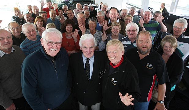 BEFORE HIS TIME: John Sinclair, centre, flanked by former All Black Nev MacEwan, left, with one of his beloved Welsh rugby supporters' groups in Palmerston North.