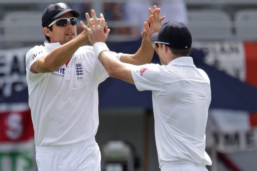 English players celebrate taking Hamish Rutherford's wicket.