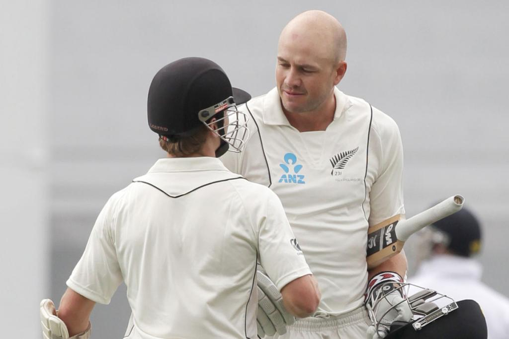 Peter Fulton is congratulated by Kane Williamson on scoring a century.