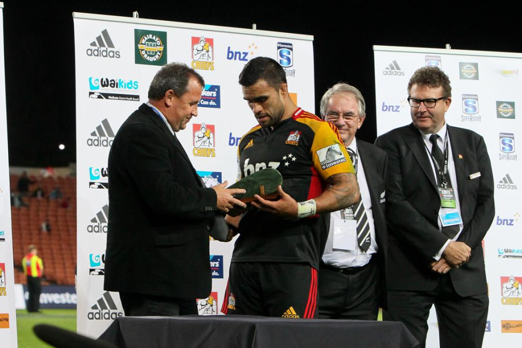 Liam Messam receives a greenstone mere from former Chiefs coach Ian Foster during a special presentation to celebrate his 100th game for the Chiefs.