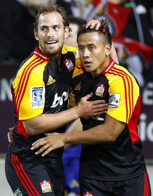Tim Nanai-Williams is congratulated after scoring the Chiefs' only try in their win over the Highlanders.