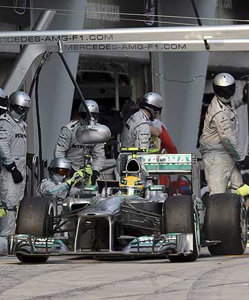 Mercedes-Benz driver Lewis Hamilton makes a pit stop during the Malayasian F1 Grand Prix.