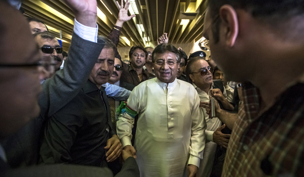 WELCOMING COMMITTEE: Pervez Musharraf arrives back in Pakistan after four years of self-imposed exile.