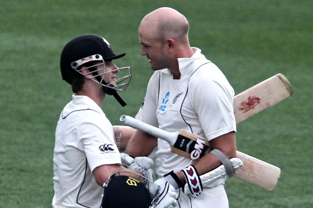 Peter Fulton is congratulated by Kane Williamson after scoring 100.