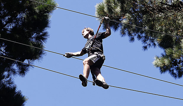 HIGH WIRE: Ben Norquay makes his way safely at Porirua's Adrenalin Forest. Adventure operators are holding a conference in Wellington in May.