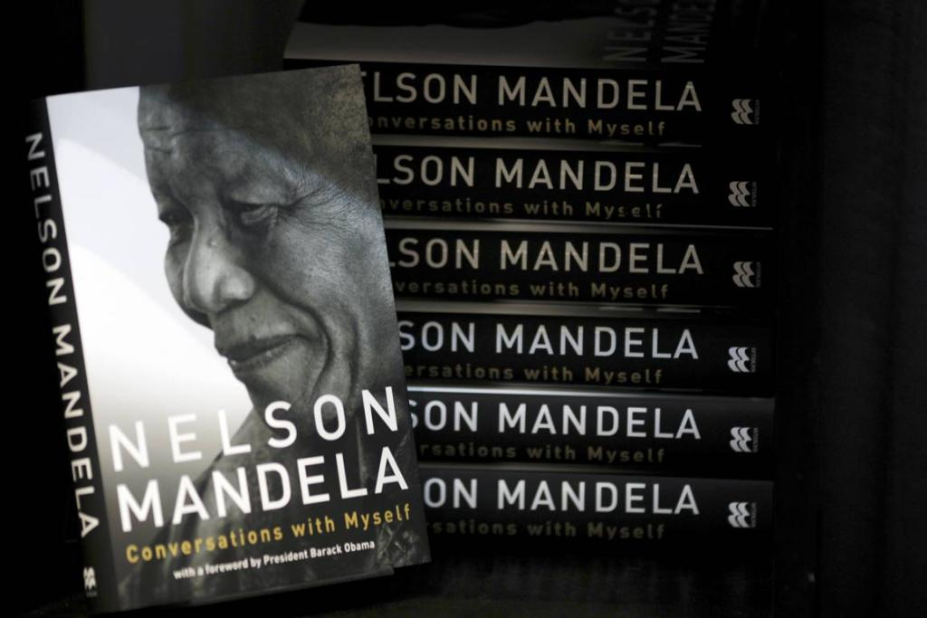 "Copies of former South Africa's president Nelson Mandela's book ""Conversations with Myself"" are displayed in a book shop window during its launch in Johannesburg October 12, 2010."