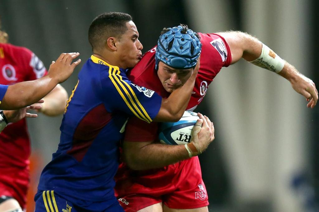James Horwill of the Reds is tackled by Aaron Smith of the Highlanders during the round seven Super Rugby match between the Highlanders and the Reds at Forsyth Barr Stadium.