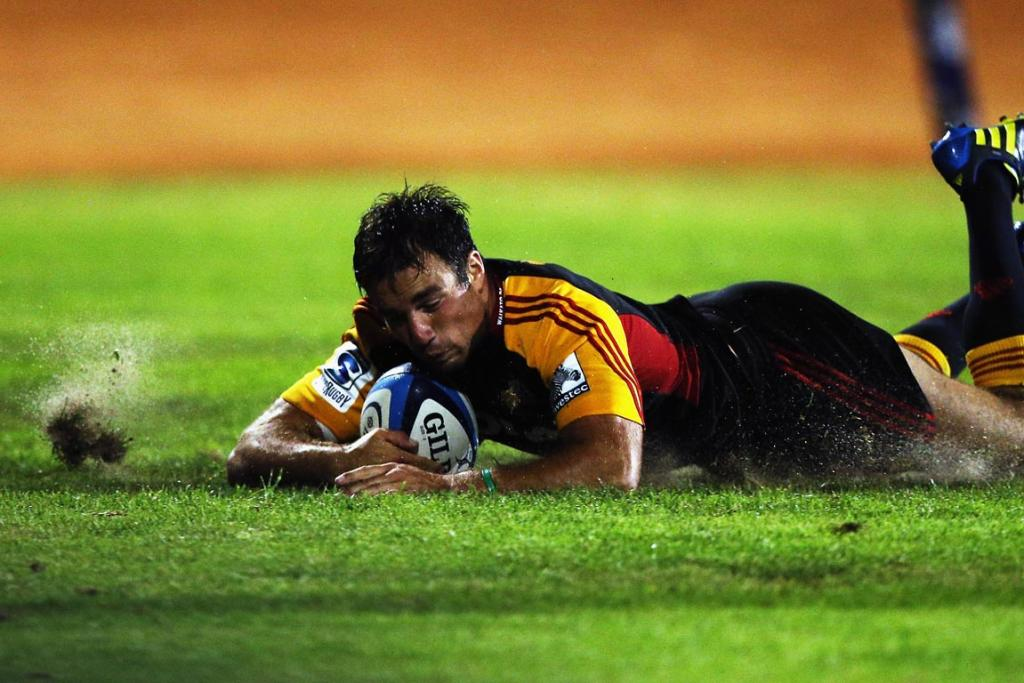 Richard Kahui of the Chiefs dives over to score a try during the round seven Super Rugby match between the Chiefs and the Blues at Bay Park.