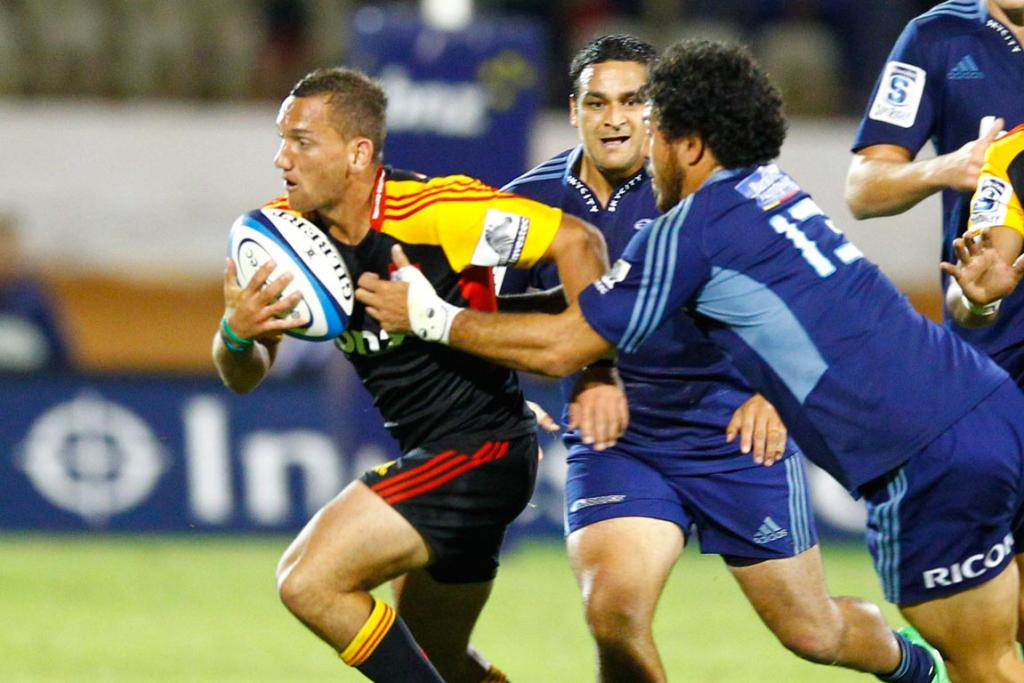 Aaron Cruden with the ball during the round seven Super Rugby match between the Chiefs and the Blues at Bay Park.