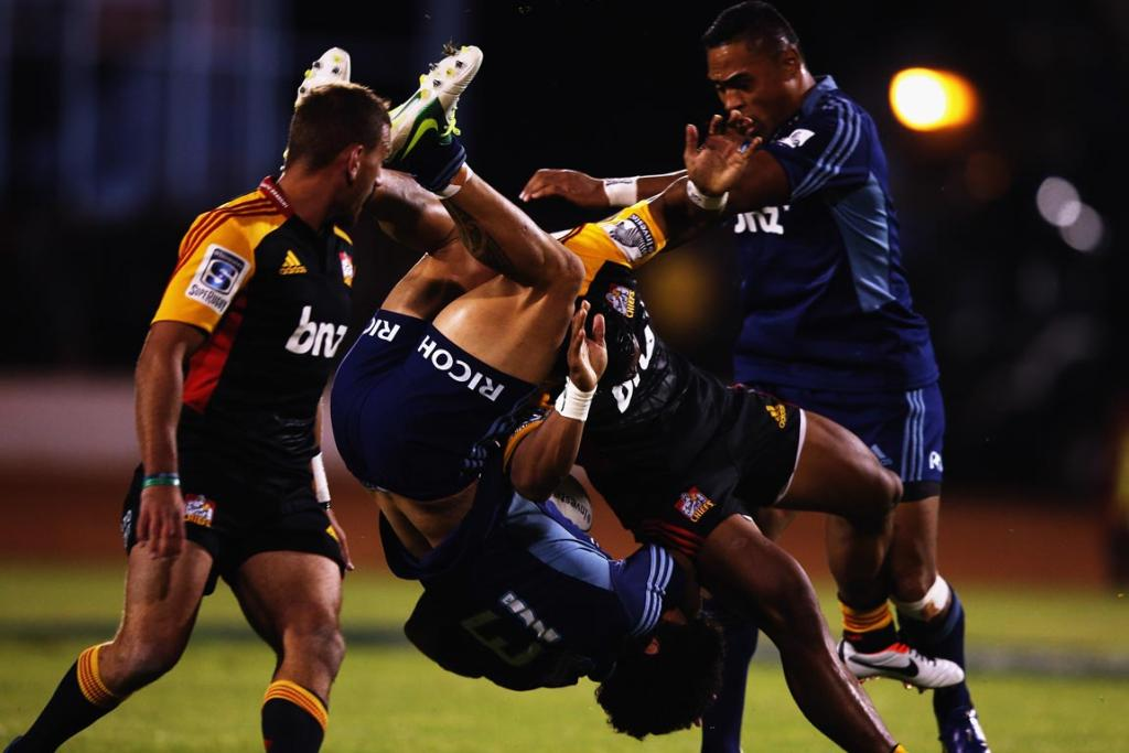 Rene Ranger of the Blues is tipped upside down during the round seven Super Rugby match between the Chiefs and the Blues at Bay Park.