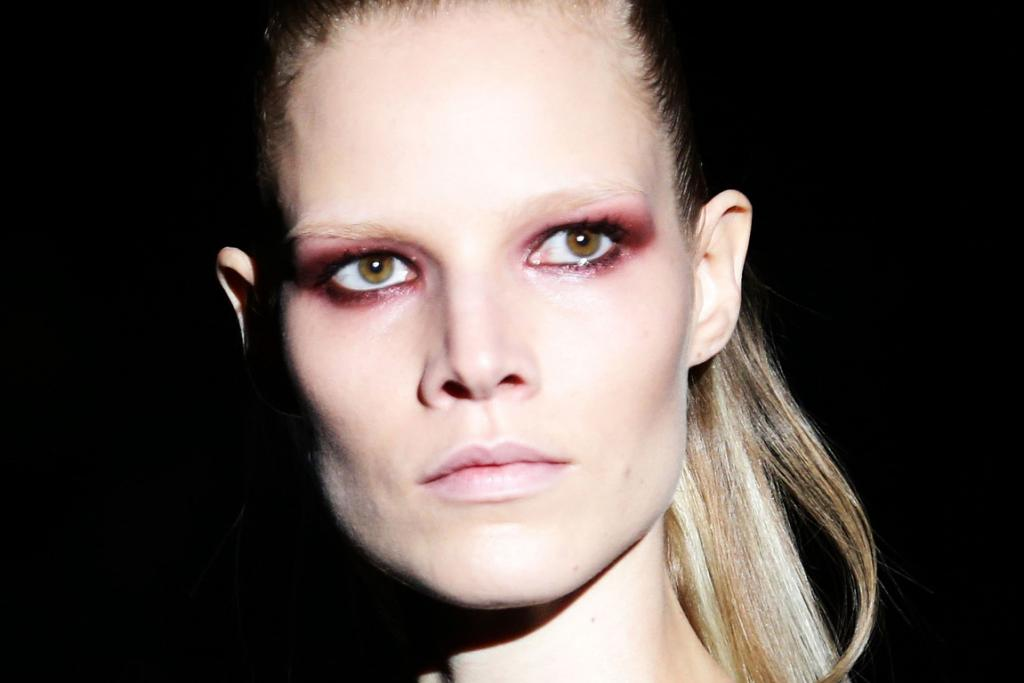 Warm eyes: A model wears plummy tones on her eyes at Gucci.