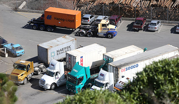 LONG WAIT: Trucks line up at the Port of Lyttelton. One driver says  he ntsGhavente has to wait between two and three hours most days to get containers loaded.