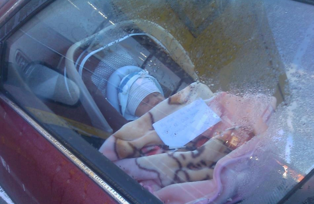 LOCKED IN: This photo of a baby in a car was posted on Facebook.