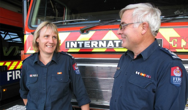 TAKING CHARGE: Incoming Riverton fire brigade chief Helen Bull talks with George Seator, who retired as chief on March 31.
