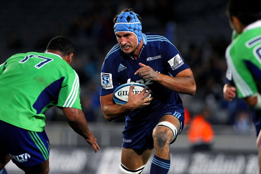 Anthony Boric prepares for the tackle during the Blues' win over the Highlanders.