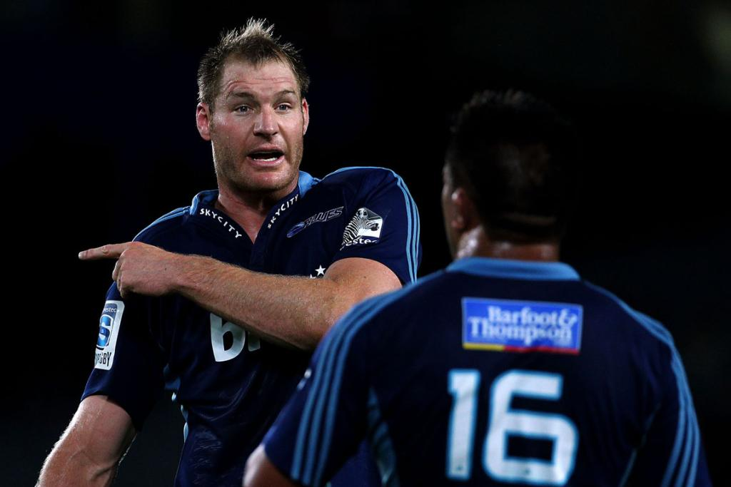 Ali Williams and Kevin Mealamu discuss a plan during the Blues' 29-18 win over the Highlanders.