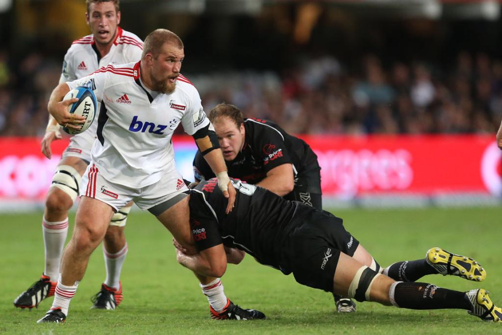 Owen Franks is tackled during the Crusaders 21-17 loss to the Sharks in Durban.